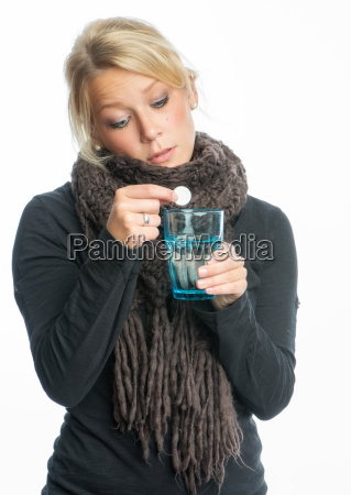 sick blond woman effervescent tablet dissolves