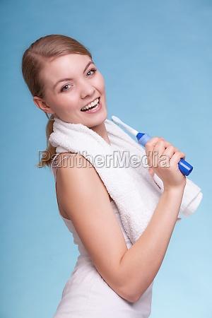 girl singing to toothbrush dental teeth