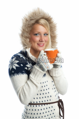 blond woman drinking from a cup