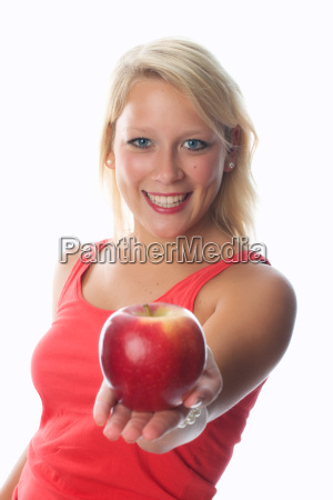 blonde woman holds a red apple