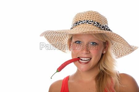 woman biting in chilli