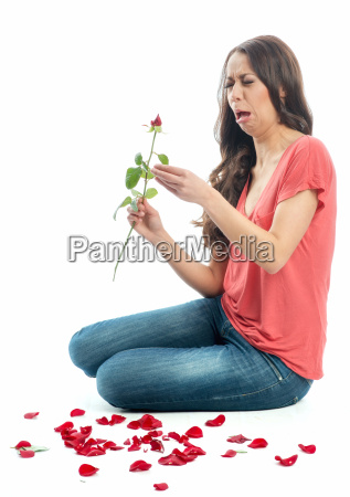 woman makes love test on flower