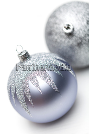 glittering silver bauble on white background