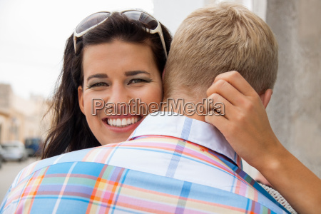 young attractive woman hugging her boyfriend