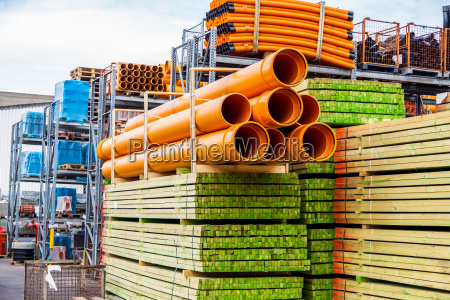 stacked different pipes for industry in