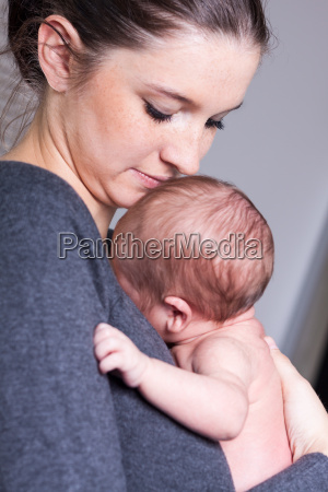 happy young mother holding her newborn