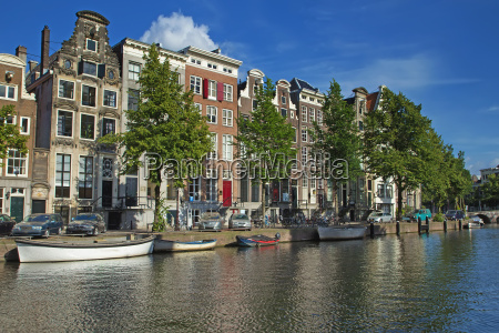 houses along the canals in amsterdam