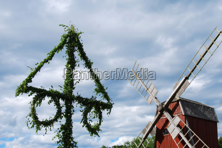 midsummer pole with a windmill