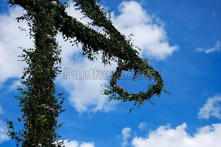 detail of midsummer pole at blue