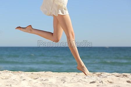 beautiful woman long legs jumping on