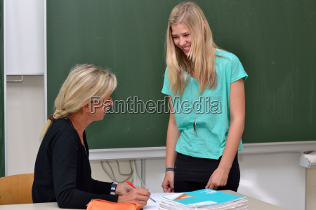 student and teacher laugh