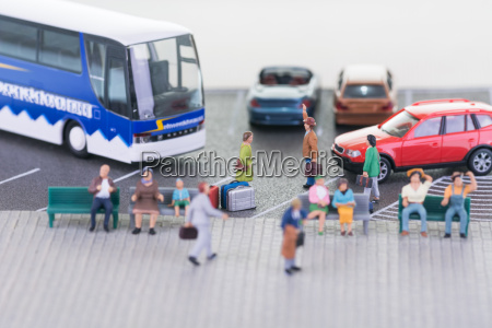 miniature travellers at a busy bus