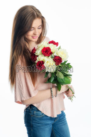 young girl holds a bouquet of