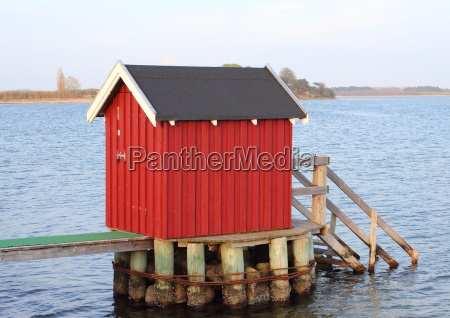 swimmers dressing house at lake in
