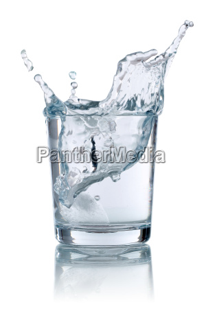 ice cubes falling into a glass