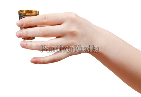 hand holds little metal cup with