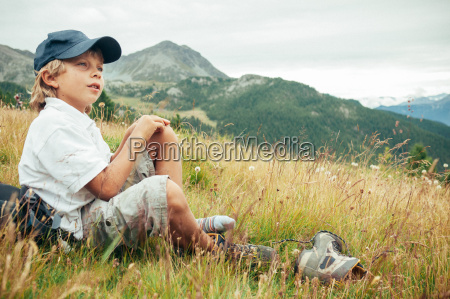 young boy takes a rest in