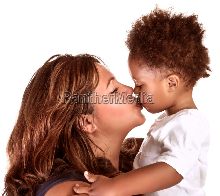 cheerful mother kissing baby