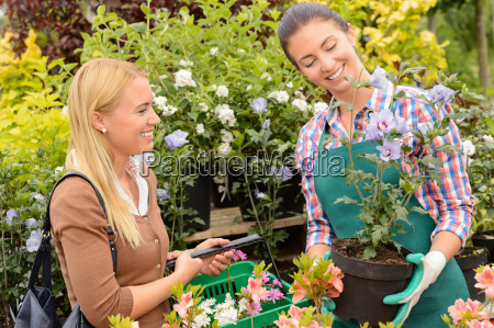 garden centre woman worker selling potted