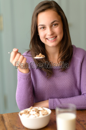 teenage girl enjoy healthy cereal breakfast