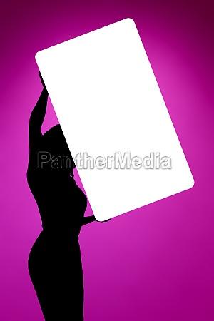 woman holding white shield