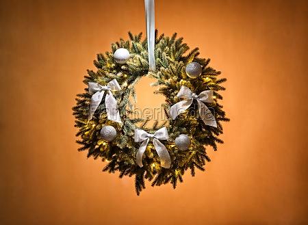 advent wreath over beige background