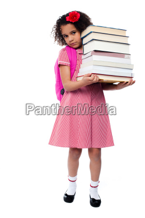 little girl with backpack and books