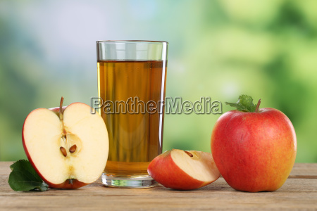 apple juice with red apple in