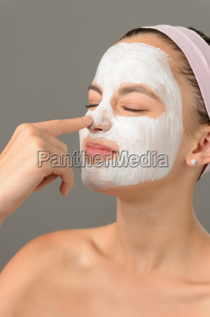 teenage beauty girl touch nose facial