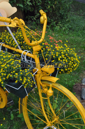 yellow bicycle with flower decoration