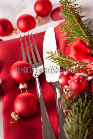 red napkin with christmas glass balls