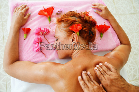 young woman getting professional spa massage
