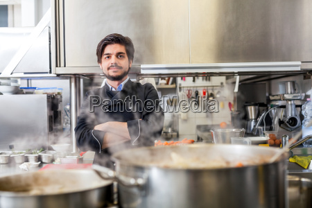 young adult chef in restaurant kitchen