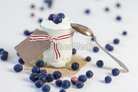 glass with yogurt un fresh blueberries