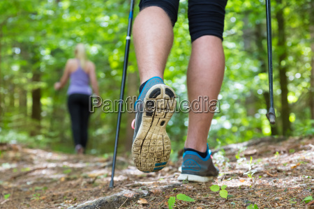 young couple hiking in nature sport