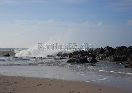 beach at ocean with breaking waves