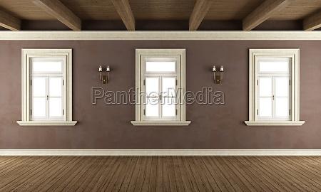 old room with three windows