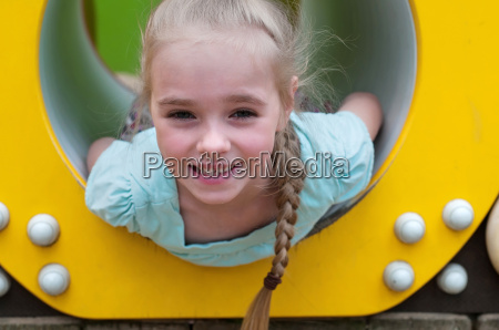 adorable young girl sitting in crawl