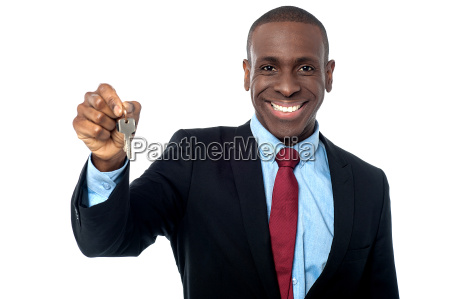 african businessman holding a key