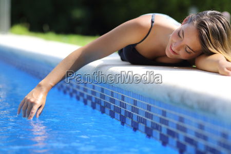 casual happy woman playing with water