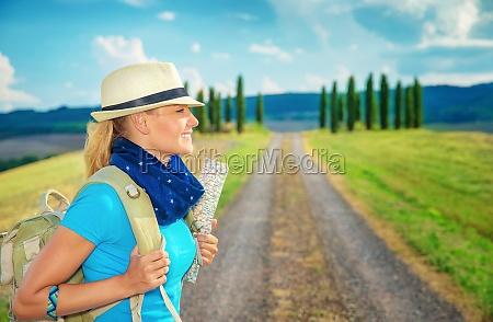 cute female trekking along europe