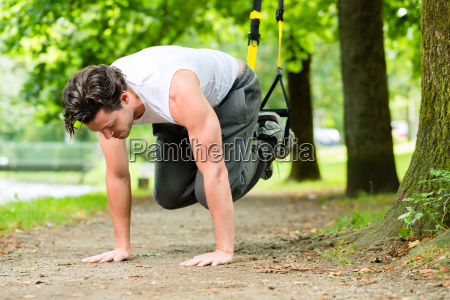 fitness man at suspension training