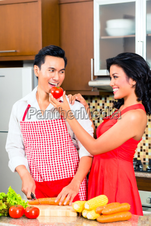 asian couple preparing food in domestic