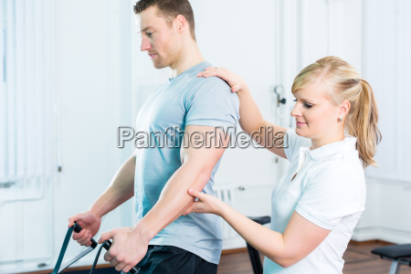 physiotherapist treats patient in practice