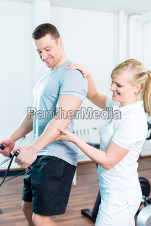 physiotherapist treats patient in practice