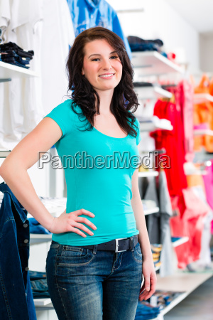woman buys clothes in the store