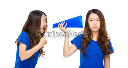 woman yell to other with megaphone