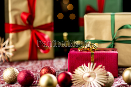 red christmas gift amidst baubles and