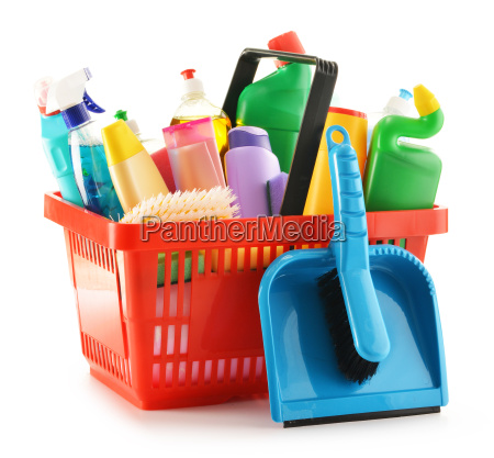 shopping basket with detergent bottles isolated