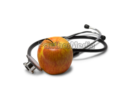 stethoscope and apple isolated on white